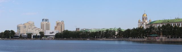Yekaterinburg City Pond with the Kosmos conference center and the church on the blood