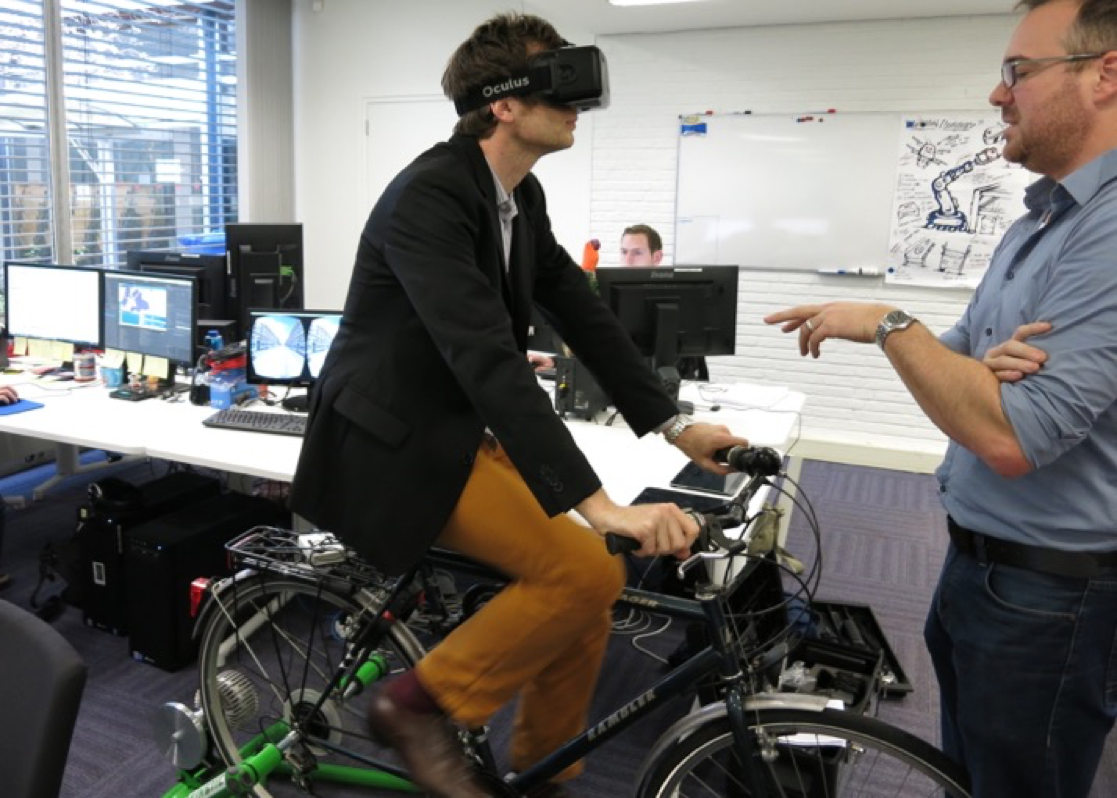 Figure 6: Alex testing VR cycling simulator developed by Atlantis Games and NHTV Breda