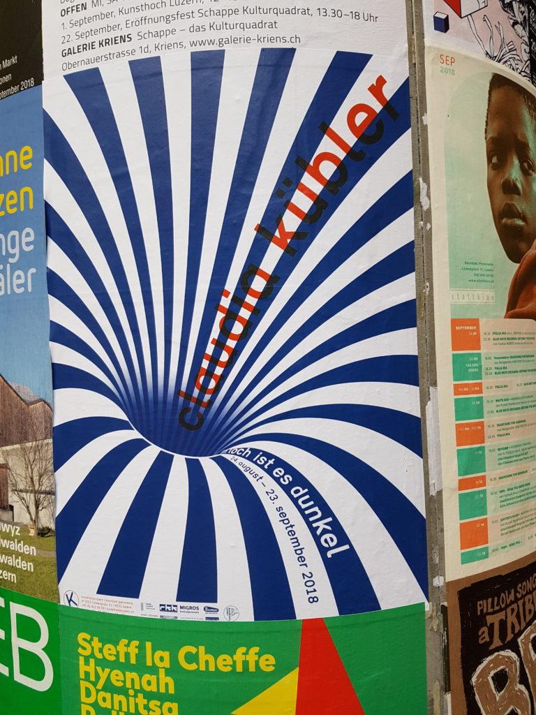 Poster pillar in Lucerne with similar logo
